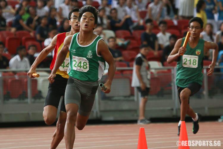 Samuel Kwan (#248) runs the third leg of the 4x400m relay. (Photo © Chua Kai Yun/Red Sports)