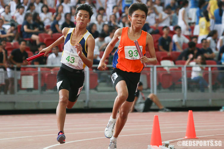 Adrian Tan (#43) of Catholic High and Jervyn Tan (#93) of North Vista Sec in action during the last leg of the 4x400m relay.  (Photo © Chua Kai Yun/Red Sports)
