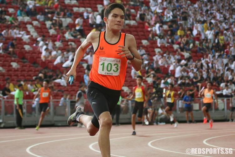 Brandon Norton (#103) of Singapore Sports School runs the second leg of the 4x400m relay. (Photo © Chua Kai Yun/Red Sports)