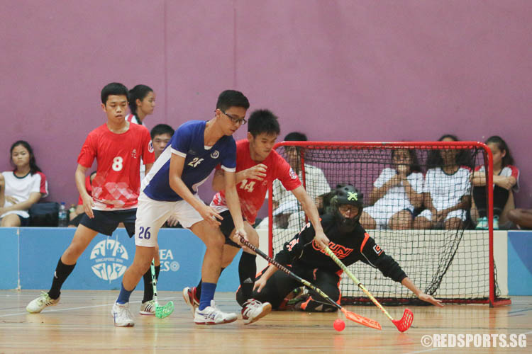 Brandon Ong (MJC #26) controls the ball while Jerrick Sik (RVHS #14) defends. (Photo © Chua Kai Yun/Red Sports)