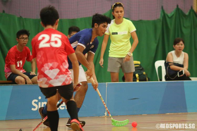 Abdul Mateen Amir Mizra (#4) of MJC dribbles towards goal against RVHS. (Photo © Chua Kai Yun/Red Sports)