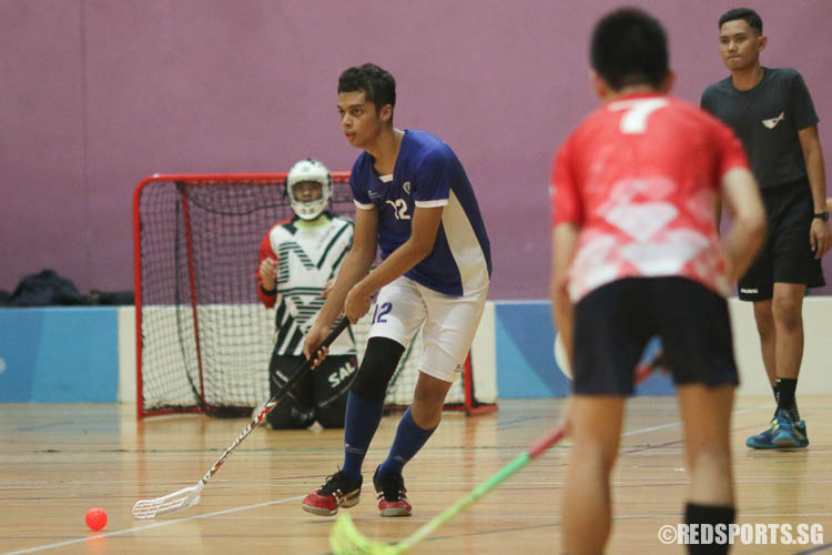Nur Hakim B Zahrin (#12) of MJC looks for an opening. (Photo © Chua Kai Yun/Red Sports)