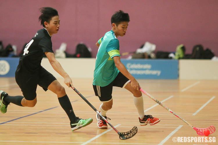 Toh Eu Juin (TJC #42) dribbles the ball against Darryl Ow (NYJC #24). (Photo © Chua Kai Yun/Red Sports)