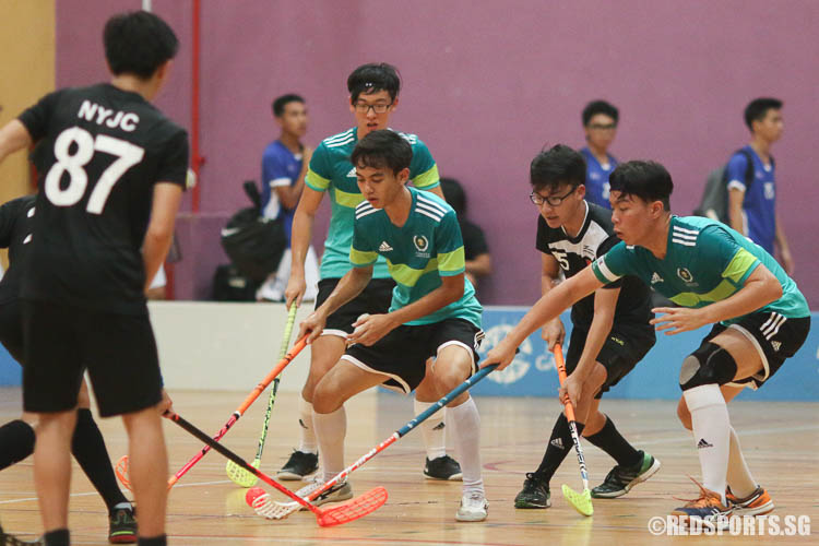 Nazmi (TJC #36, centre) and Joshua Ong (TJC #24, right) controlling the ball against NYJC.  (Photo © Chua Kai Yun/Red Sports)