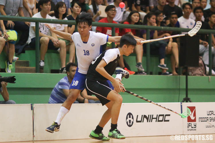 Jeremy Chia (MJC #18) attempts to escape colliding into Ryan Tan (RI #68). (Photo © Chua Kai Yun/Red Sports)