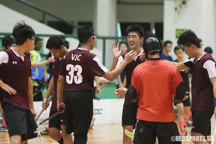 VJC players congratulating Koh Dun Xian (#5) after his third goal. (Photo © Chua Kai Yun/Red Sports)