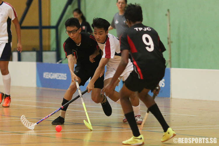 Muhammad Ismail (#6) attacks against two TPJC defenders. The YJC captain scored 2 goals for his team. (Photo © Chua Kai Yun/Red Sports)