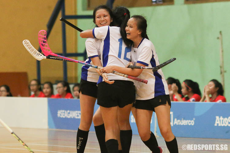 CJC players celebrate their first goal by Clara Mui (#9, left). (Photo © Chua Kai Yun/Red Sports)