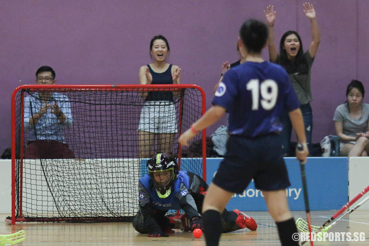 Goalkeeper Kong Qiu Yii (RVHS #1) saves the ball by Vera Peh (HCI #21) in the last few seconds of the game, sealing the game with a final score of 2-1. (Photo © Chua Kai Yun/Red Sports)