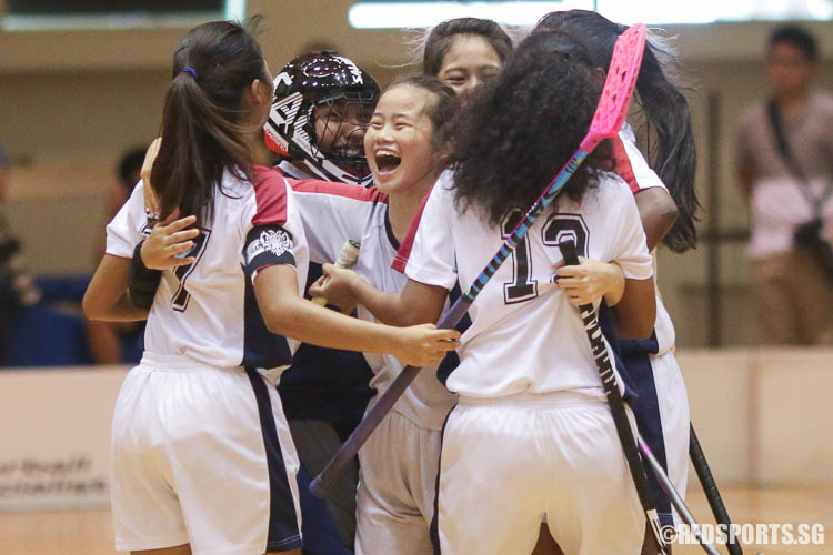 YJC players celebrate their first goal by Alicia Chia (#2, centre). (Photo © Chua Kai Yun/Red Sports)