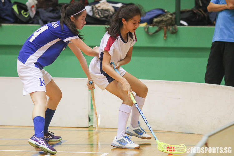 Victoria Heng (YJC #26) handles the ball against Janessa Kong (MJC #14), who scored the opening goal. (Photo © Chua Kai Yun/Red Sports)