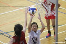 Rindy Kok (GA) of ACJC aims for the net. (Photo © Chua Kai Yun/Red Sports)