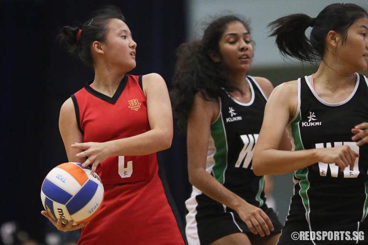Janna Poong (C) of HCI handles the ball against RI. (Photo © Chua Kai Yun/Red Sports)