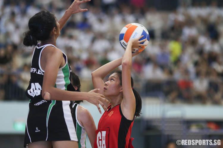 Isabelle Wang (GA) of HCI aiming for a shot.  (Photo © Chua Kai Yun/Red Sports)
