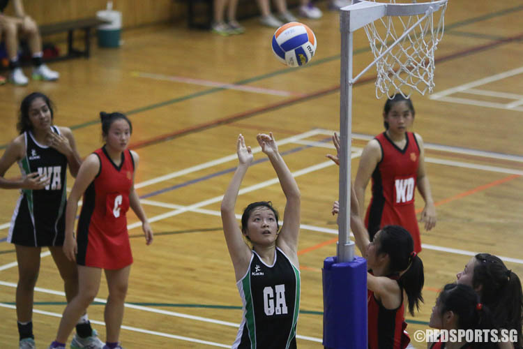 Valerie Shao (GA) scoring a goal against HCI. (Photo © Chua Kai Yun/Red Sports)