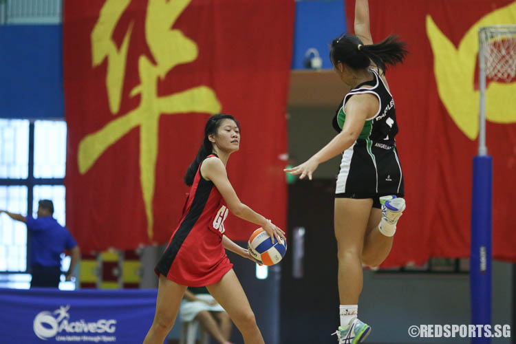 Low Yixuan (GK) of HCI in action against Angelica Lim (C) of RI. (Photo © Chua Kai Yun/Red Sports)