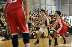 Krison Sum (RI #12) collects the ball and drives towards the basket.