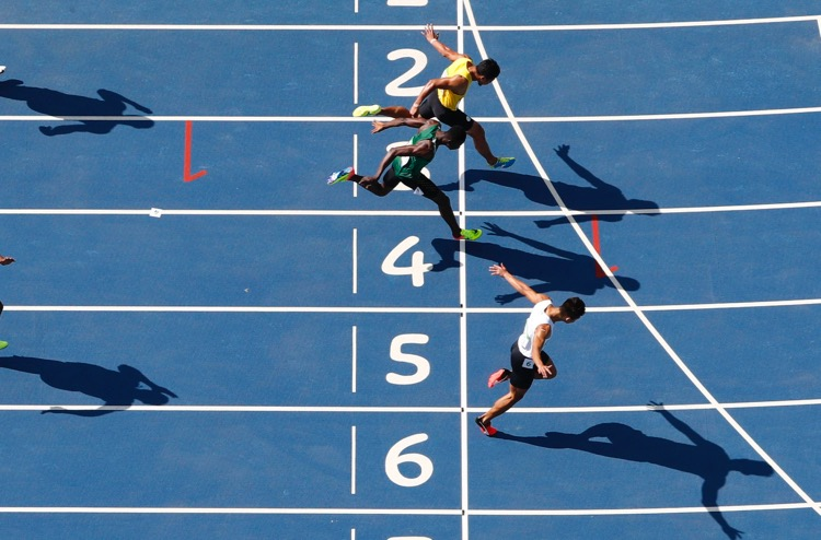 2016 Rio Olympics - Athletics - Preliminary - Men's 100m Preliminary Round - Olympic Stadium - Rio de Janeiro, Brazil - 13/08/2016. Timothee Yap (SIN) of Singapore, Ismail Kamara (SLE) of Sierra Leone and Mohammad Fakhri Ismail (BRU) of Brunei cross the finish line.  TSRIO2016 REUTERS/Fabrizio Bensch