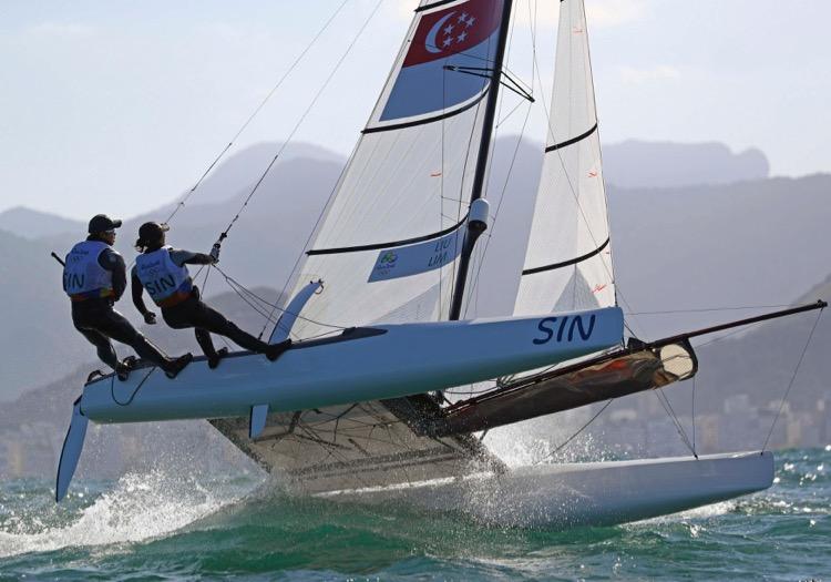 2016 Rio Olympics - Sailing - Preliminary - Mixed Multihull - Nacra 17 - Race 7/8/9 - Marina de Gloria - Rio de Janeiro, Brazil - 13/08/2016. Justin Liu (SIN) of Singapore and Denise Lim (SIN) of Singapore compete. TSRIO2016 REUTERS/Brian Snyder
