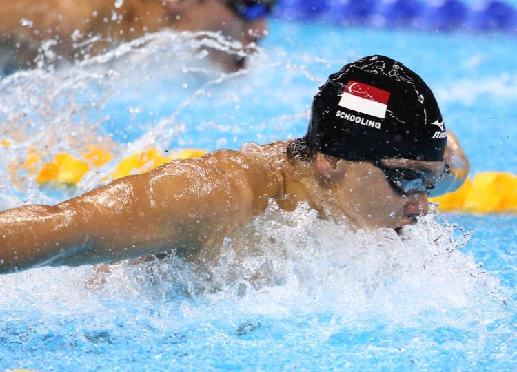 2016 Rio Olympics - Swimming - Final - Men's 100m Butterfly Final - Olympic Aquatics Stadium - Rio de Janeiro, Brazil - 12/08/2016. Joseph Schooling (SIN) of Singapore celebrates winning the gold medal.