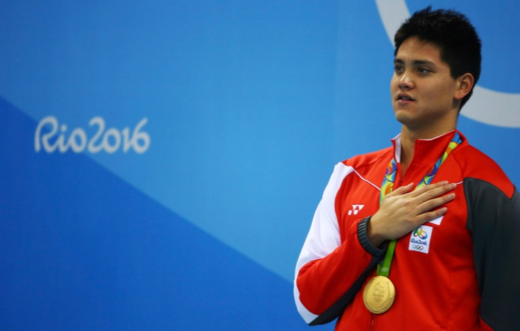 2016 Rio Olympics - Swimming - Victory Ceremony - Men's 100m Butterfly Victory Ceremony - Olympic Aquatics Stadium - Rio de Janeiro, Brazil - 12/08/2016. Joseph Schooling (SIN) of Singapore sings the national anthem. TSRIO2016 REUTERS/Michael Dalder