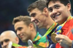 2016 Rio Olympics - Swimming - Victory Ceremony - Men's 100m Butterfly Victory Ceremony - Olympic Aquatics Stadium - Rio de Janeiro, Brazil - 12/08/2016. Gold medallist Joseph Schooling (SIN) of Singapore poses with joint silver medallists Michael Phelps (USA) of USA, Chad Le Clos (RSA) of South Africa and Laszlo Cseh (HUN) of Hungary. TSRIO2016 REUTERS/Dominic Ebenbichler FOR EDITORIAL USE ONLY. NOT FOR SALE FOR MARKETING OR ADVERTISING CAMPAIGNS.