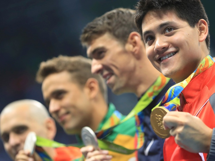 2016 Rio Olympics - Swimming - Victory Ceremony - Men's 100m Butterfly Victory Ceremony - Olympic Aquatics Stadium - Rio de Janeiro, Brazil - 12/08/2016. Gold medallist Joseph Schooling (SIN) of Singapore poses with joint silver medallists Michael Phelps (USA) of USA, Chad Le Clos (RSA) of South Africa and Laszlo Cseh (HUN) of Hungary. TSRIO2016 REUTERS/Dominic Ebenbichler