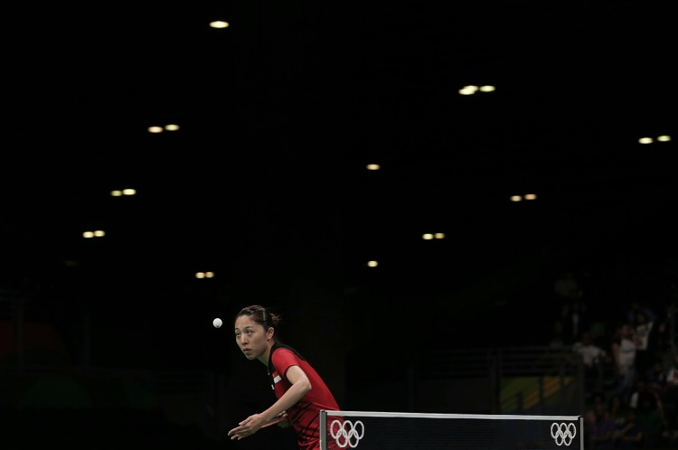 2016 Rio Olympics - Table Tennis - Quarterfinals - Women's Singles - Riocentro - Pavilion 3 - Rio de Janeiro, Brazil - 09/08/2016. Yu Mengyu (SIN) of Singapore eyes the ball during play against Kim Song I (PRK) of North Korea. TSRIO2016  REUTERS/Alkis Konstantinidis