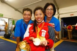 2016 Rio Paralympics - Swimming - Women's 50m Backstroke - S2 - Finals - Aquatic Stadium - Rio de Janeiro, Brazil - 15/09/2016.  Singapore's Yip Pin Xiu celebrates with her parents Yip Chee Khiong and Margaret Chong (R) TSRIO2016 REUTERS/Jason O'Brien  FOR EDITORIAL USE ONLY. NOT FOR SALE FOR MARKETING OR ADVERTISING CAMPAIGNS.