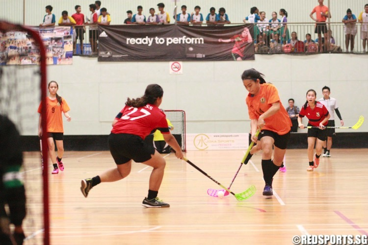 Tanjong Katong (orange) beat St. Margaret's 7-3 to retain the National C Division Girls Floorball Championship. (Photo © Les Tan/Red Sports)