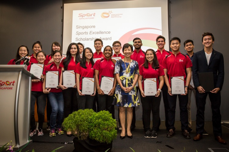 Minister Grace Fu with some of the spexScholars at an awards ceremony in March 2016. (Photo courtesy of MCCY)