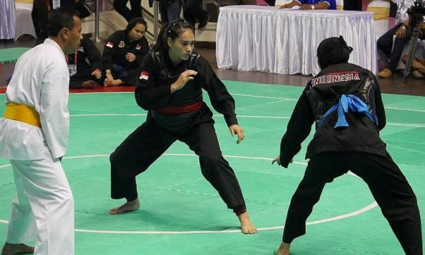 Singapore silat exponent Nurul Suhaila Mohd Saiful (with red sash) was defeated by reigning world champion Selly Andriani of Indonesia, in the semi-final of the World Pencak Silat Championships. (Photo Courtesy of PERSISI)