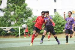 Muhammad Ilhan Mansiz Bin Mazlan (#5) of Serangoon Garden Secondary School and Mas Ridzwan B Mohamat Ali (Right) of NorthLight Secondary School clashes for the ball. Both players scored one goal respectively for their teams. (Photo 1 © Stefanus Ian/Red Sports)