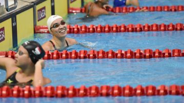Roanne Ho smiling after finishing first in the Women's 50m Breaststroke final on the third day of the 13th Singapore National Swimming Championship. (Photo © Stefanus Ian/Red Sports)