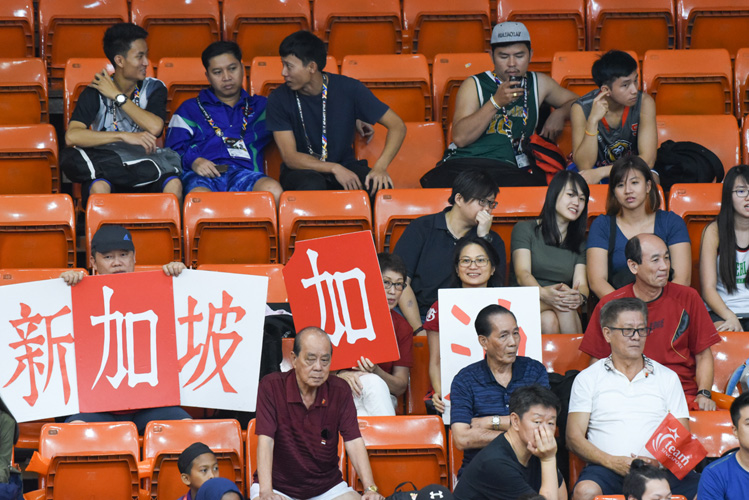 Hiroshi Yosida, Lynda Dyeo, Lim Phang Boon and Ann Lim holding support signs for Team Singapore during a basketball match. (Photo 1 by Stefanus Ian/Sport Singapore)