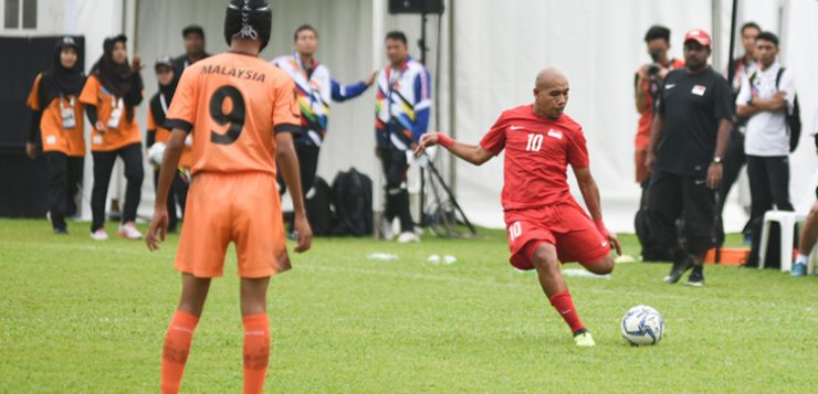 Khairul Anwar scoring Singapore's second goal of the match from a free kick.