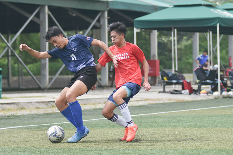 Jerall Yu (RVHS #11) guarding the ball during a NYSI JC League match between Raffles Institution and River Valley High School. (Photo © Stefanus Ian/Red Sports)