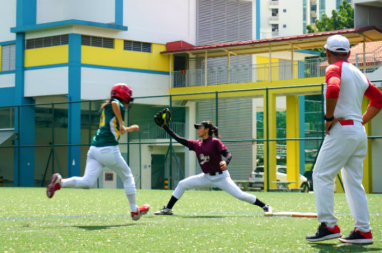 Sheryl (#27) of Tanjong Katong Girls' School catches the ball to oust Adele (#81) of Cresent Girls School to end the inning during the game of Crescent Girls School against Tanjong Katong Girls' School. (Photo by © Pang Chin Yee /REDIntern)