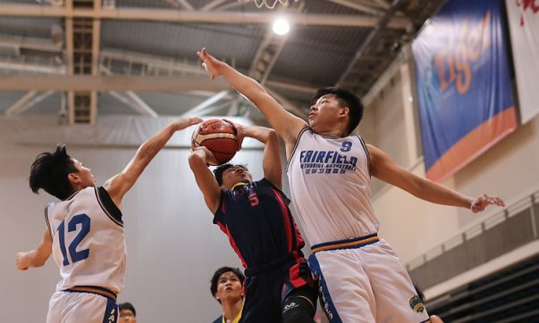 Panca (#15) of ACS (Baker) shoots against Jonathan Ang (#9) and Russell Lim (#12) of Fairfield Methodist. (Photo © Lee Jian Wei/Red Sports)