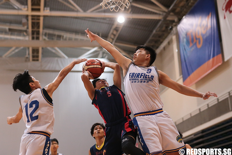 Panca (#15) of ACS (Barker) shoots against Jonathan Ang (#9) and Russell Lim (#12) of Fairfield Methodist. (Photo 1 © Lee Jian Wei/Red Sports)