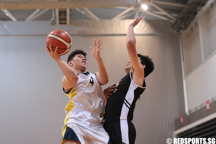 Lacdao John (#4) of Guang Yang Secondary goes for the layup against Ngai Yan Tai (#26) of Raffles Institution. (Photo © Lee Jian Wei/Red Sports)