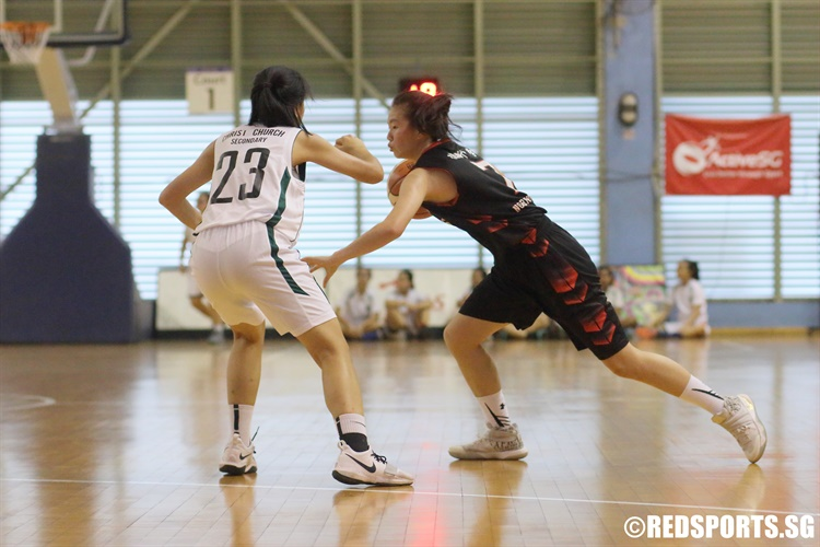Lydia Ang (NV #7) drives the ball against Christ Church Secondary. She played a crucial role in securing victory for her team. (Photo 1 © Dylan Chua/Red Sports)