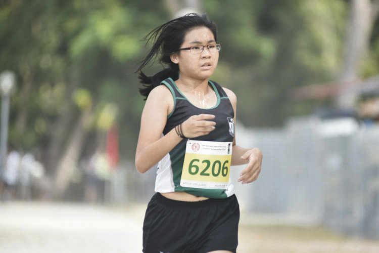 Hou Li Jun Athena (#6206) of Raffles Girls' School came in twelfth with a timing of 17:32 in the C Division Girls. (Photo © Eileen Chew/Red Sports)