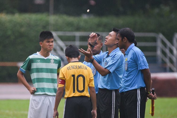 SJI and Bendemeer captains waiting for the results of the coin flip before the match. (Photo © Stefanus Ian/Red Sports)
