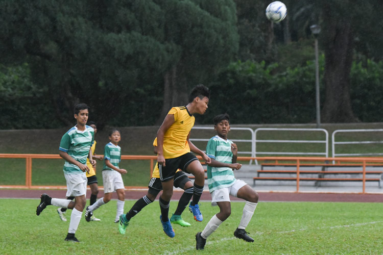 A Bendemeer player making a clearance. (Photo © Stefanus Ian/Red Sports)