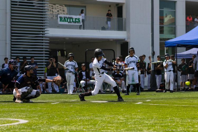 Max Koh (RI #11) making a swing