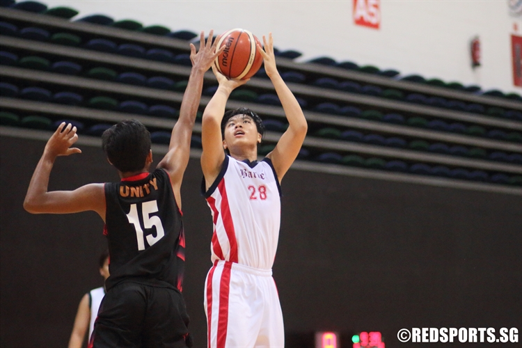 Xavier Tan (#28) rises for a shot over the defense. He led ACSB with 17 points. (Photo © Chan Hua Zheng/Red Sports)