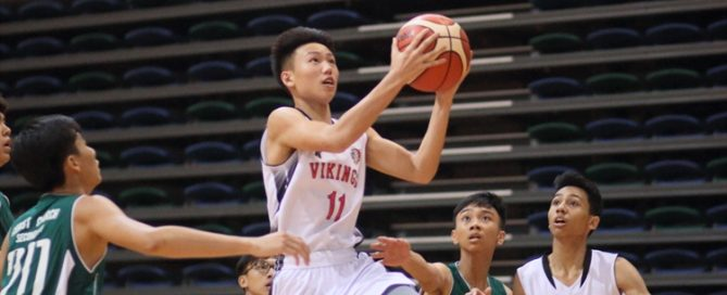Justen Chiam (NV #11) rises for a lay-up en route to a 14-point outing. (Photo © Chan Hua Zheng/Red Sports)