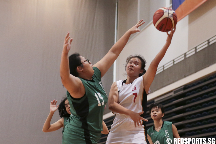 Valerie Lim (#7) of Jurong Secondary shoots against  Atalanta Lim (#15) of Anglican High. (Photo © Lee Jian Wei/Red Sports)