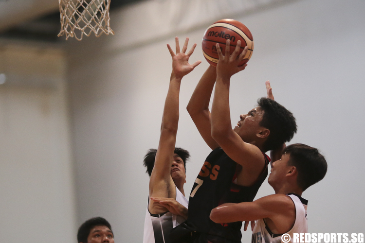 Nicholas Leong (#7) of Unity Secondary shoots against Mayflower Secondary. (Photo © Lee Jian Wei/Red Sports)
